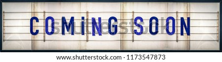 A Grungy Old Weathered Coming Soon Marquee Sign With Blue Letters #1173547873