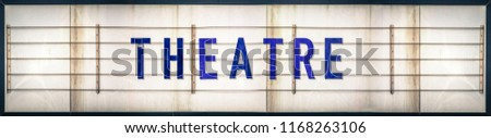 A Grungy Old Weathered Theatre Marquee Sign With Blue Letters #1168263106