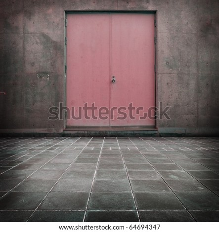 A grungy room with red door.