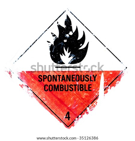 A grungy spontaneously combustible - warning isolated on white.