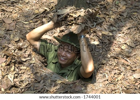 A guide demonstrating how a Vietcong hide into the Tunnel