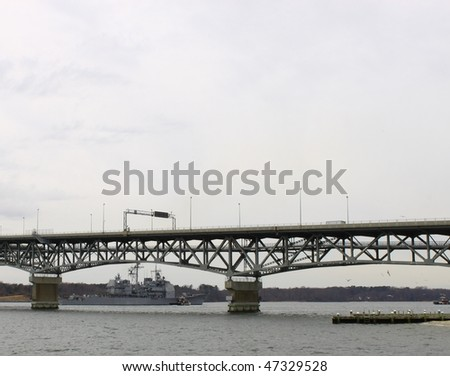 a guided missile cruiser after it passed through the bridge on the way up river to the naval weapons station in yorktown virginia
