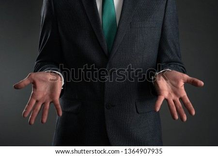A guilty business man is spreading his arms and make excuses. Business problem. Business misunderstanding. Stock photo ©