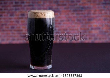 A Guinness dark Irish dry stout beer glass that originated in the brewery in dublin horizontal view Stock photo ©