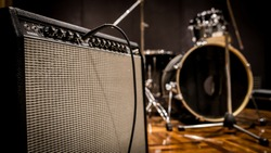 A guitar amp and drumset in live perform mini session.