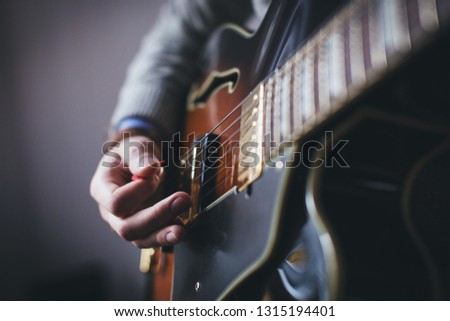 A guitarist (or a guitar player) is a person who plays the guitar. Guitarists may play a variety of guitar family instruments such as classical guitars, acoustic guitars, electric guitars, and bass.
