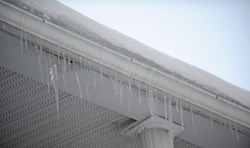 A gutter with ice cubes in winter