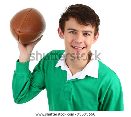A guy holding a rugby ball isolated on white
