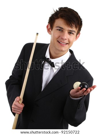 A guy holding a snooker cue and two balls isolated on white.
