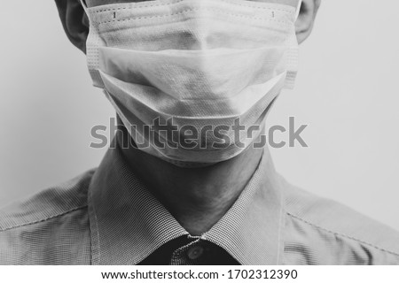 A guy in a white medical mask. Black and white photography.