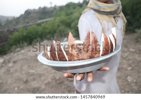 A Guy Sells fresh Coconut Slices
