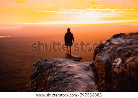 A guy standing on reeds lookout in the grampians national park outside of Melbourne Stock photo ©