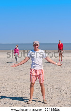 a guy standing with girls jumping