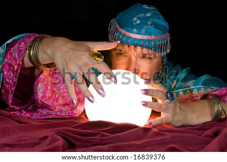 A gypsy fortune teller brings her crystal ball to life to read the future.