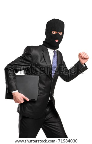 A hacker in robbery mask running with laptop isolated against white background