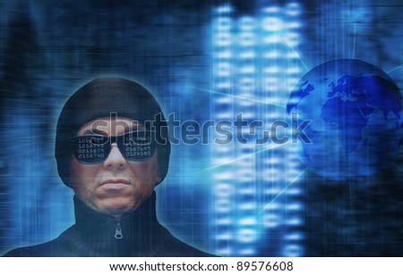 a hacker with computer code reflections on glasses