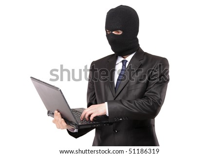 A hacker working on a laptop isolated on white background - stock photo