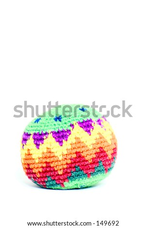 A hacky sack isolated on a white background.