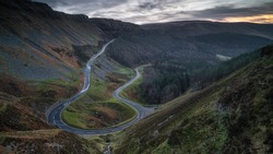 A hairpin bend in a steep mountain road. The road is located in the lower Brecon Beacons, south Wales.
