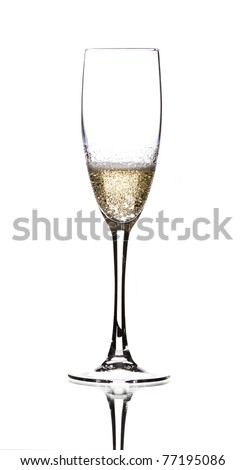 a half-full glass of champagne at a celebration