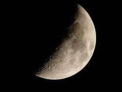 a half lit moon in the nightsky