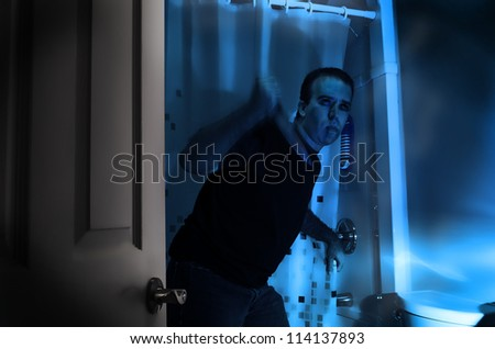 A halloween killer is sneaking around in a bathroom, about to murder someone in the shower.