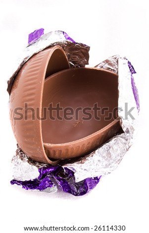 A halved milk chocolate Easter egg in foil wrapping