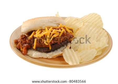 A hamburger smothered in child and cheese
