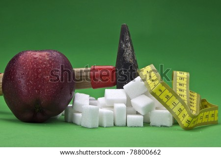 a hammer which is disturbing sugar cubes for a healthier nutrition in the future