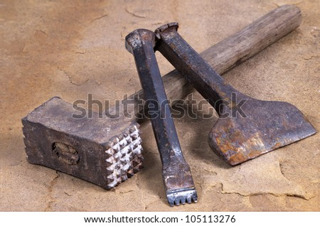 a hammer with two chisels