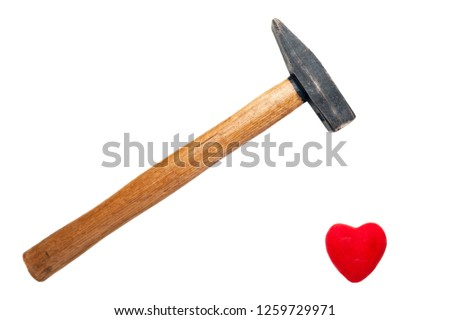 A Hammer with Wooden Handle Ready to Break, Crush Red Heart Isolated on White Background. Minimalist Healthcare, Heart attack risk, Relationship Breakup Symbol. Card, Message, Banner Design. #1259729971