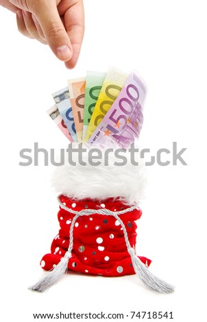 a hand aiming to take a bank note from a red present-bag isolated on a white background - stock photo