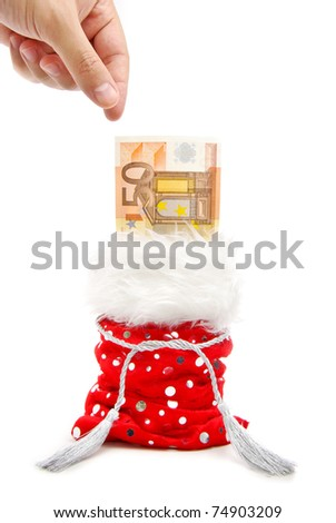 a hand aiming to take a bank note from a red present-bag isolated on a white background