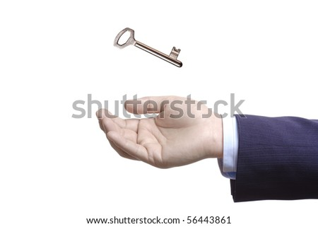 A hand and a key isolated on white background
