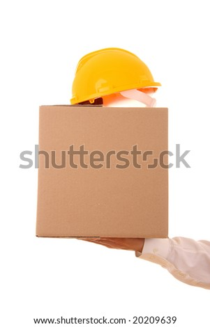 A hand carrying a cardboard box and a security helmet