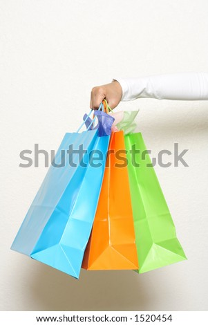 A hand carrying shopping bags