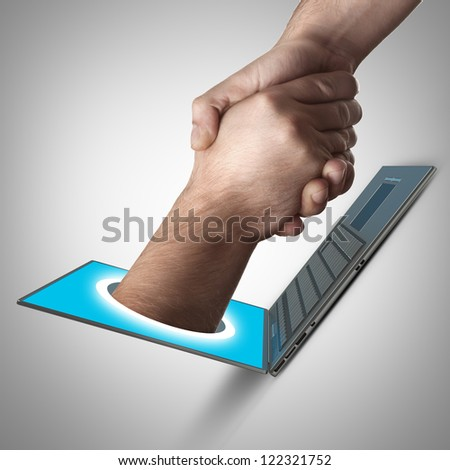 A hand comes right out of the laptop screen to shake hands CONCEPT. High resolution - stock photo