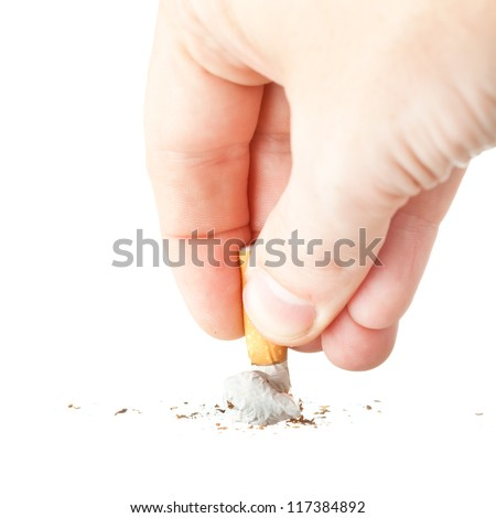 a hand extinguishing a cigarette on white background