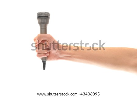 A hand gripping a silver microphone isolated on white background with lots of copyspace.