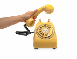 a hand hold yellow old classic style telephone