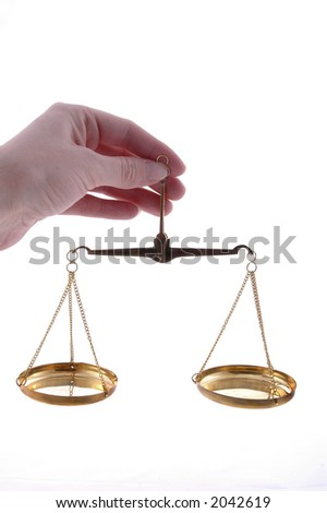A hand holding a balance scale.