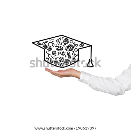 A hand holding a graduation hat.