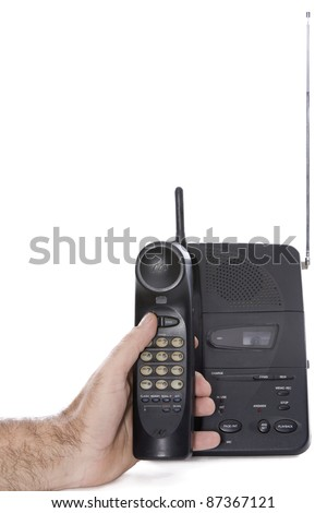 a hand holding a little old phone numbers to call by dialing - stock photo