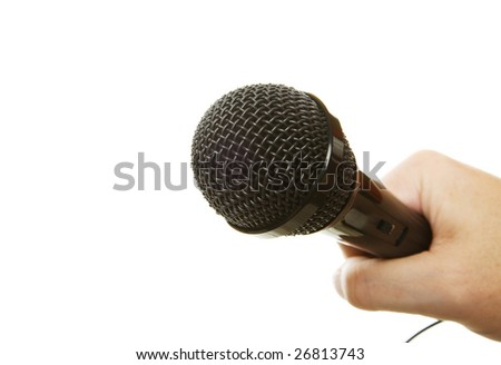 A hand holding a microphone on a white background