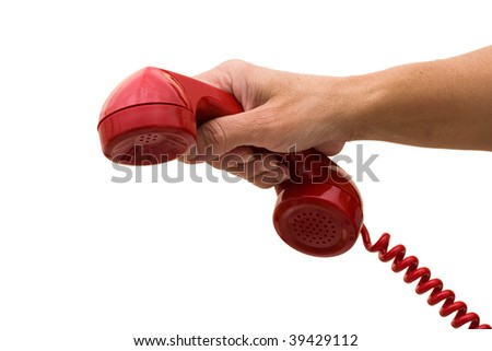 A hand holding a red handset of a telephone isolated on a white background, answering the telephone