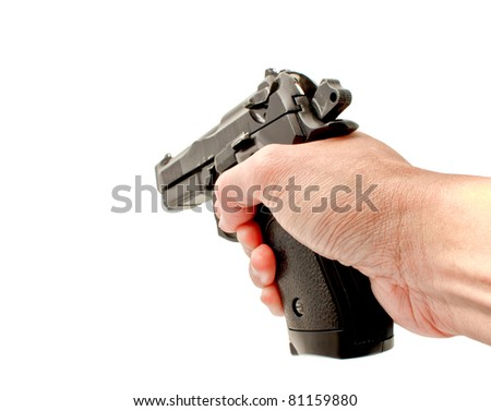 A hand holding a semi automatic handgun that is in ready position to shoot, studio shot