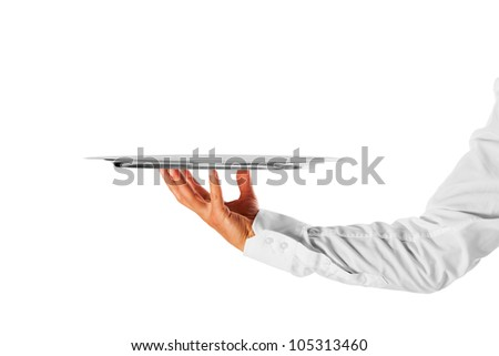 A hand holding a silver tray
