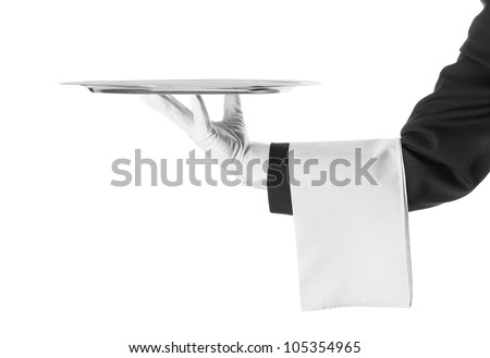 A hand holding a silver tray - stock photo