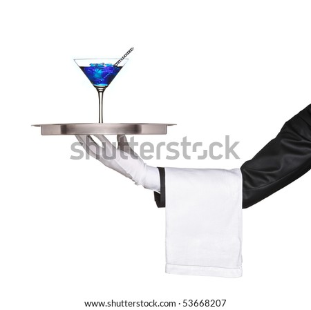A hand holding a silver tray with a blue cocktail on it isolated on white background