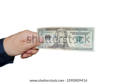 A hand holding 20 dollar bills. Studio isolated on a white background with an accurate clipping path. #1090809416